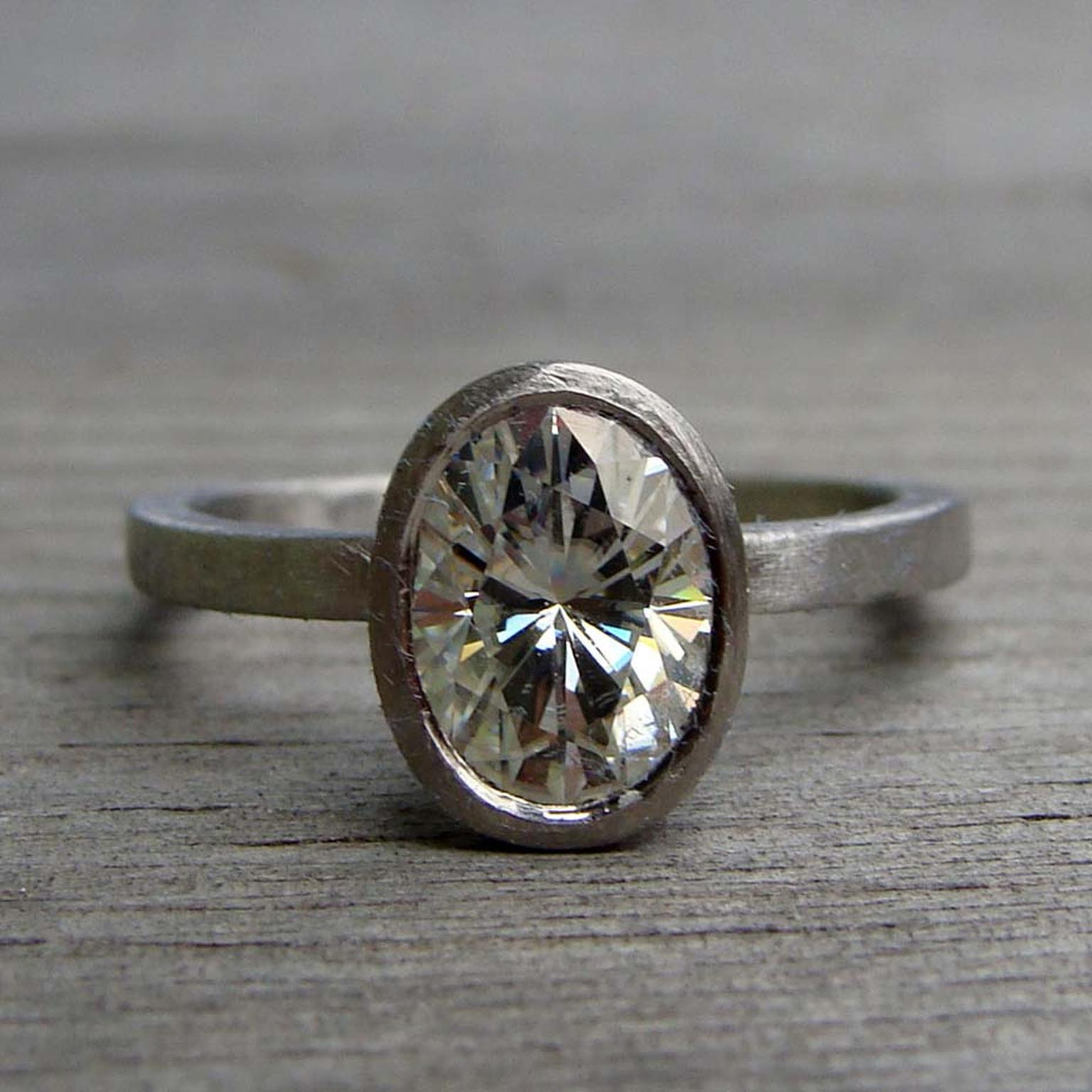 McFarland Designs recycled white gold engagement ring featuring a Forever Brilliant Moissanite.