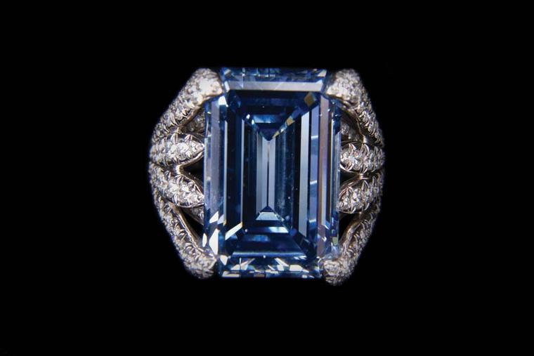 Verdura platinum Eight Blades ring featuring blue and white diamonds, set with a central 14.71ct emerald-cut blue diamond.