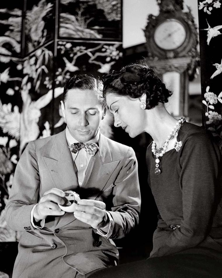 Duke Fulco di Verdura with Coco Chanel examining the signature Maltese cuffs he made for Ms Chanel.