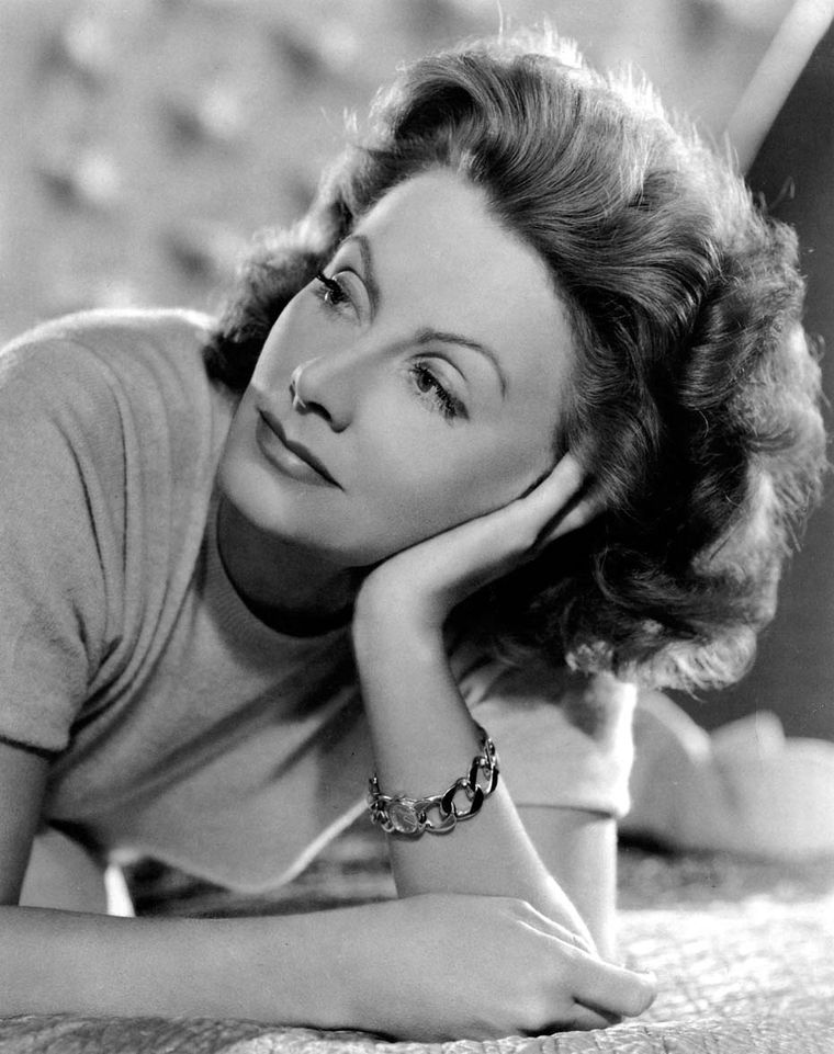 A demure Greta Garbo in a photograph taken by the famous photographer Clarence Sinclair Bull wearing a Verdura gold bracelet.