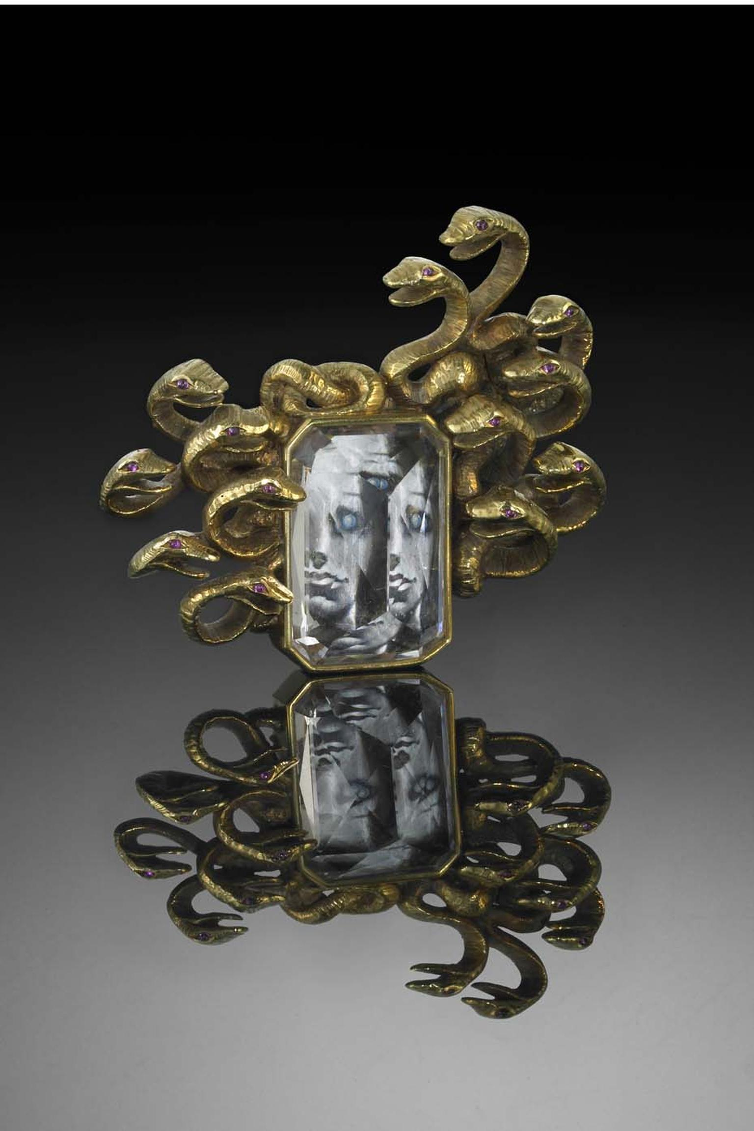 Verdura and Salvador Dali's 1941 Medusa collaboration: a gold, morganite and ruby brooch framing a miniature painting of Medusa.