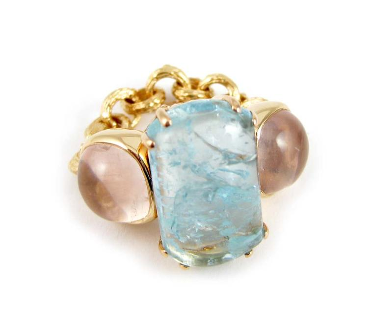 K. Brunini Chains of Love Twig ring in yellow gold with a central 12.08ct aquamarine and two rose quartz ($8,880).