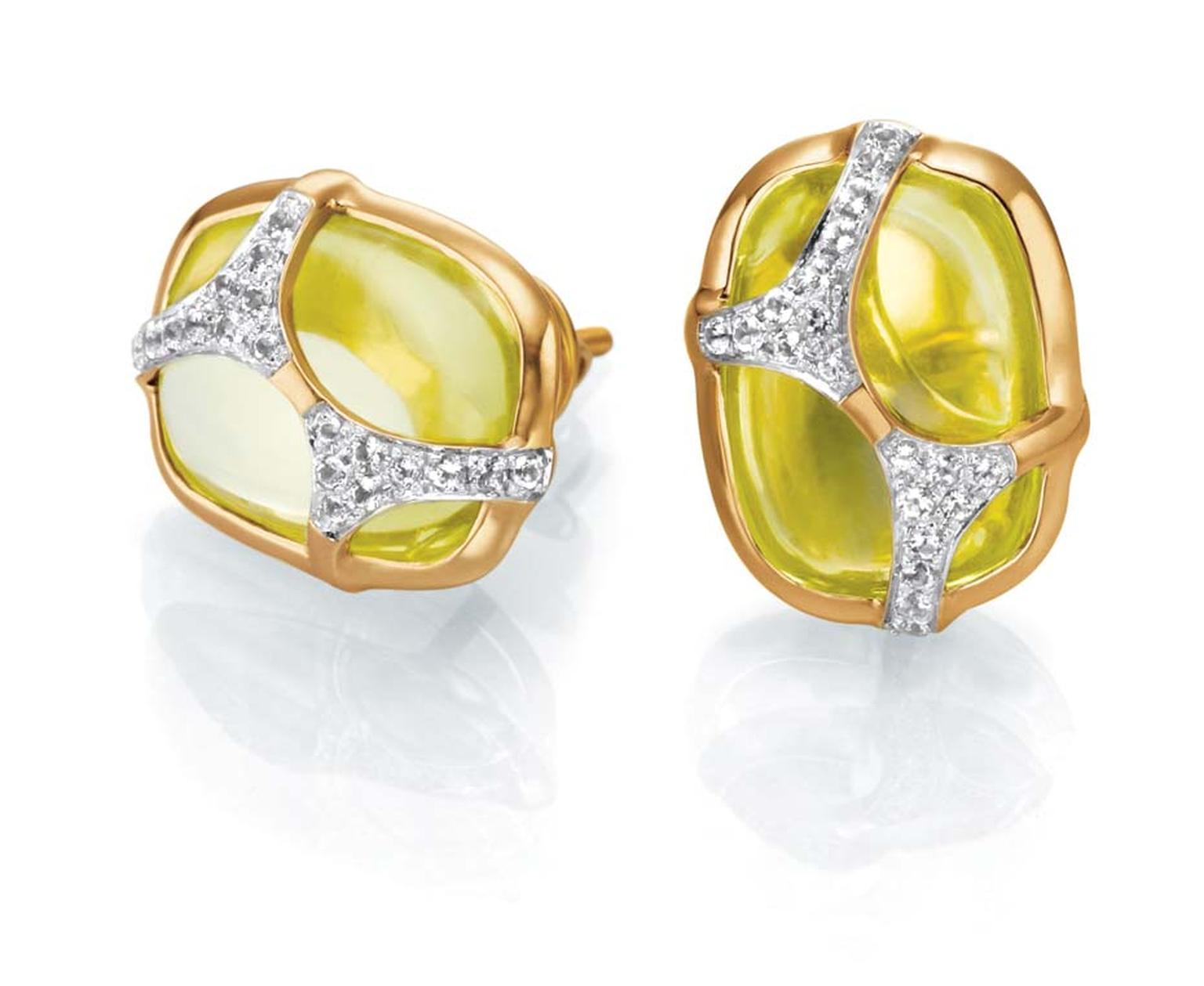 Tanishq IVA 2 collection gold ear studs with peridots, overlaid with diamonds.