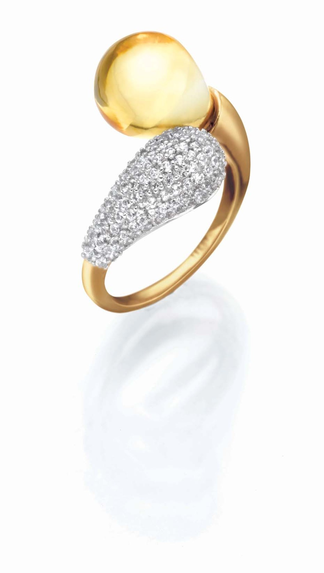 Tanishq IVA 2 collection gold ring with pavé diamonds and a citrine curling around the finger.