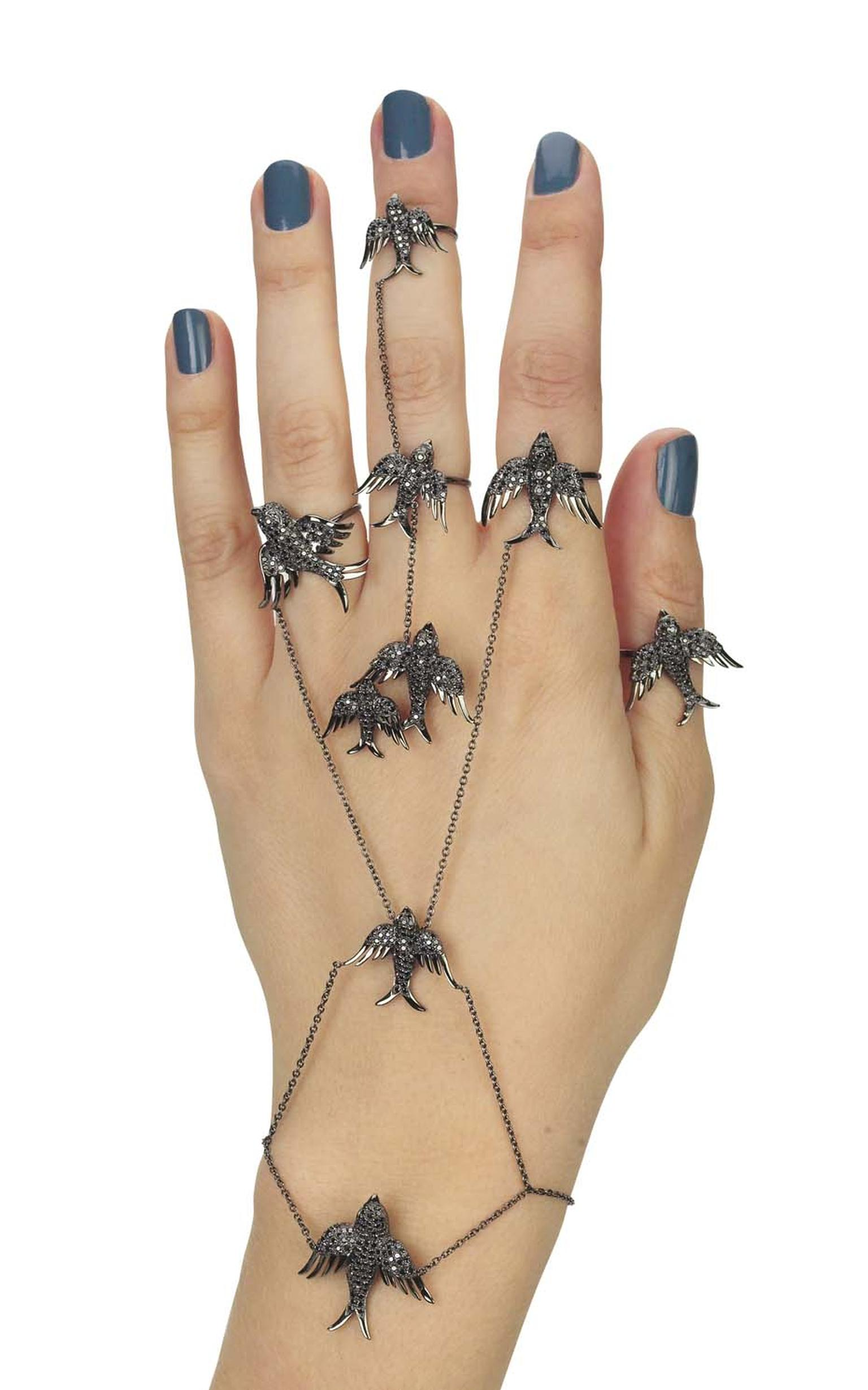 Colette Blue Drift black gold Installation of Birds hand jewel with black diamonds ($15,760).