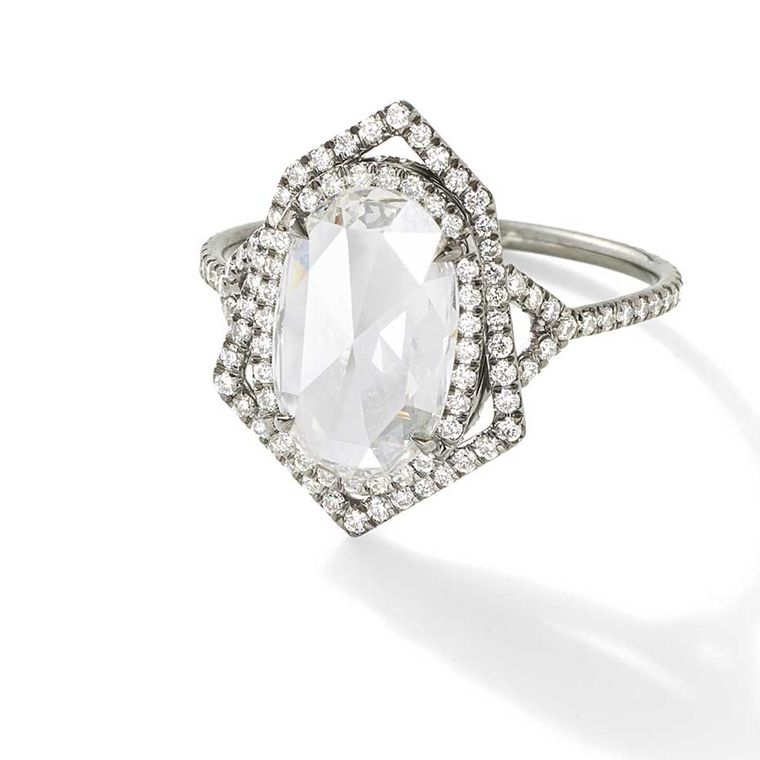 Monique Péan Mineraux engagement ring in recycled oxidised platinum, set with an antique white oval rose cut diamond and diamond pavé ($52,770).