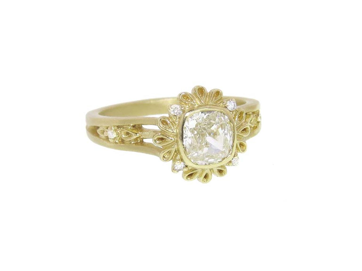Megan Thorne's detailed Plume engagement ring in yellow gold featuring a cushion-cut diamond.