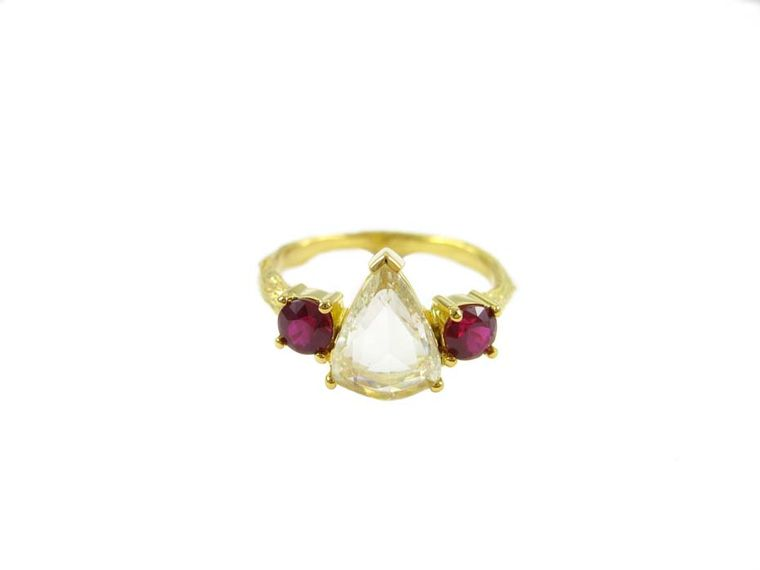 K Brunini Twig engagement ring featuring a centre pear-shaped diamond with two deep-red ruby side stones.