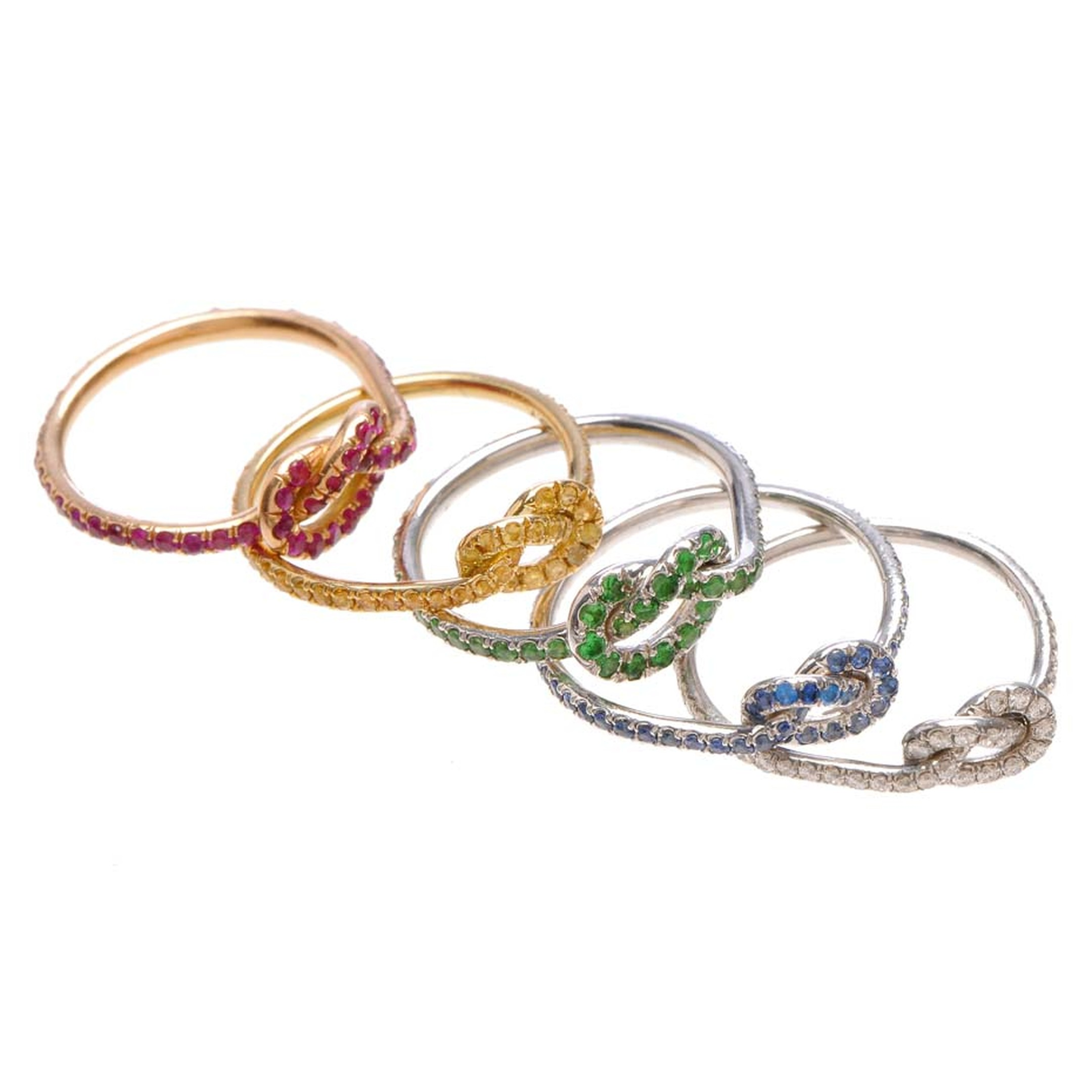 Finn Jewelry Love Knot rings available in a range of stackable hues.