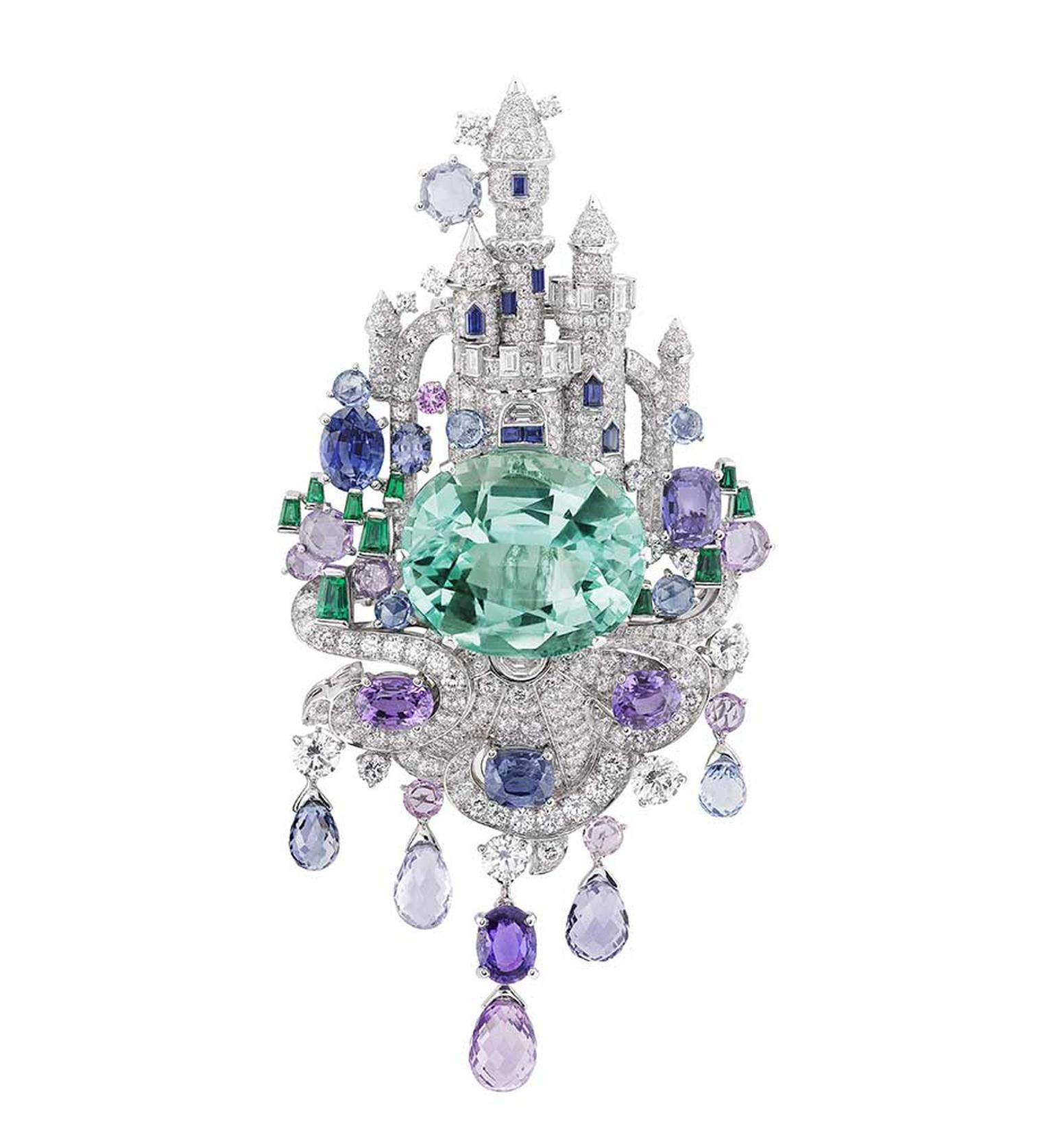 Van Cleef & Arpels Peau d'Âne collection white gold Enchanted Castle brooch with multiple cut diamonds, emeralds, sapphires and briolette gemstones surrounding a 39ct oval cut emerald.
