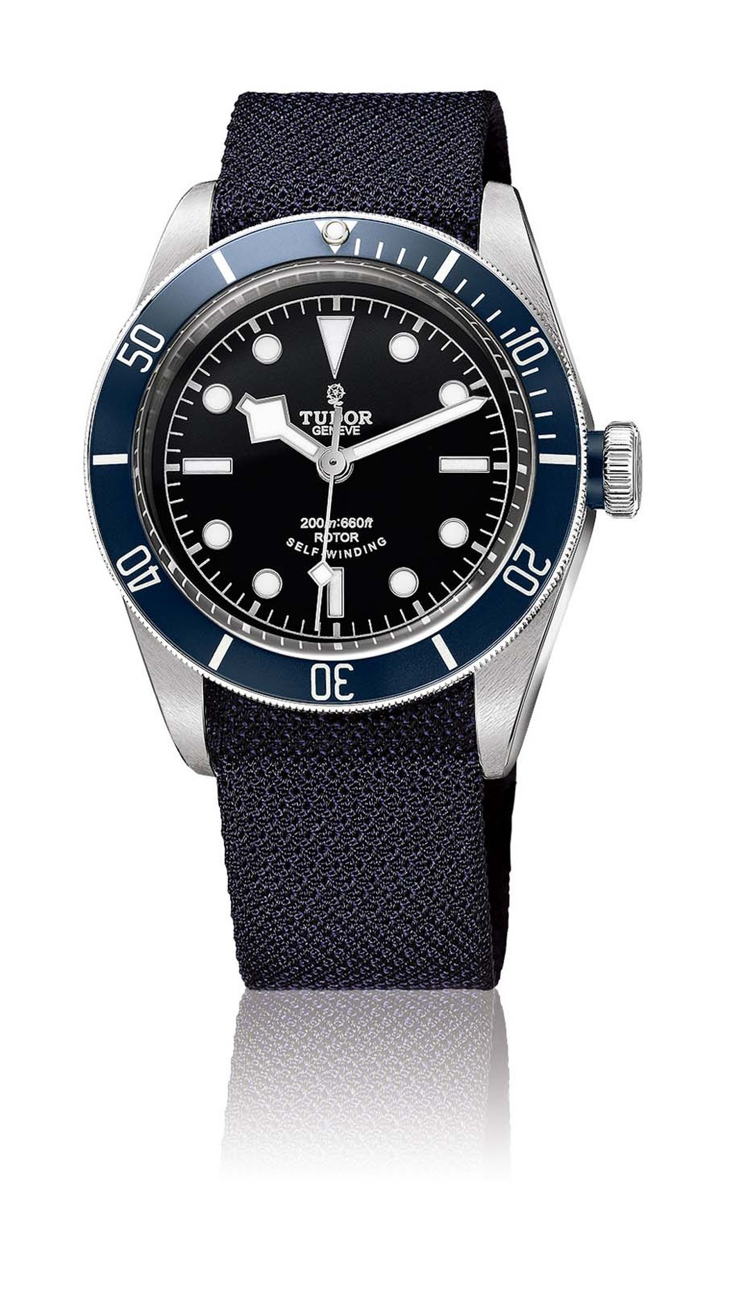 Tudor's Heritage Black Bay Marine Nationale dive watch features a rotating blue bezel and three straps, including a steel bracelet, leather strap and a black/blue textile strap.