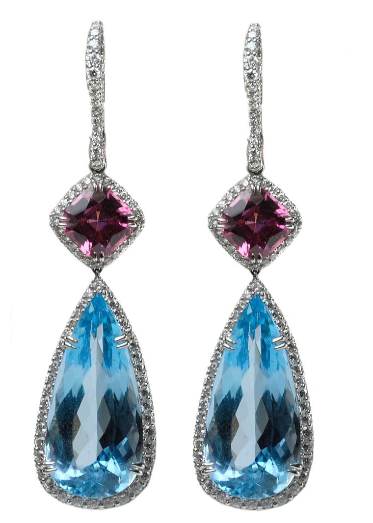 Lucie Campbell platinum earrings featuring pear-shaped aquamarine drops with spinel tops, surrounded by diamonds.