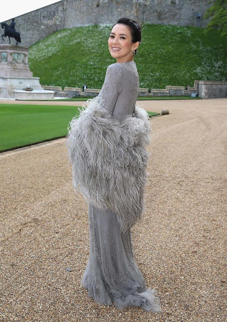 Zhang Ziyi in a Ralph Lauren in a grey beaded tulle evening gown, worn with a feather stole, with Ralph Lauren Stirrup earrings pavéd with diamonds.