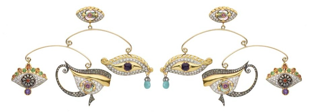 Sylvie Corbelin Fascination collection mobile earrings' featuring three uniquely shaped gem-encrusted eyes suspended from a central stud, also in the shape of an eye.