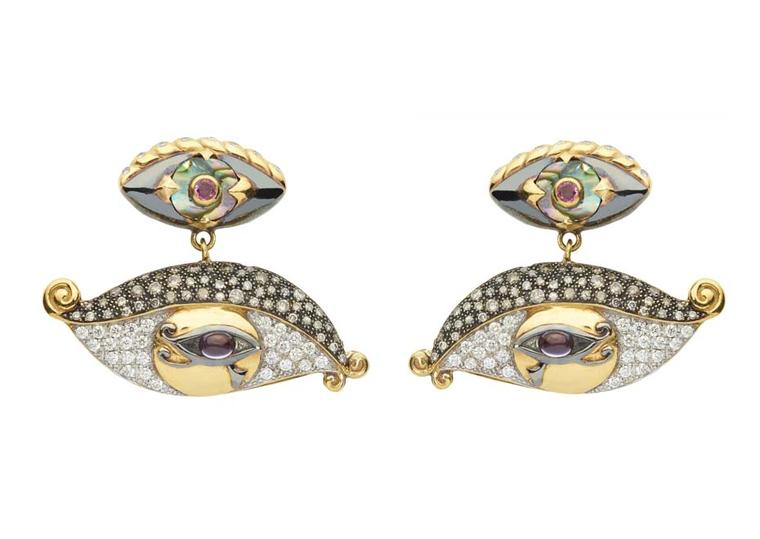 Sylvie Corbelin Fascination collection earrings featuring diamond and gem-encrusted eyes suspended from a central stud, also in the shape of an eye.