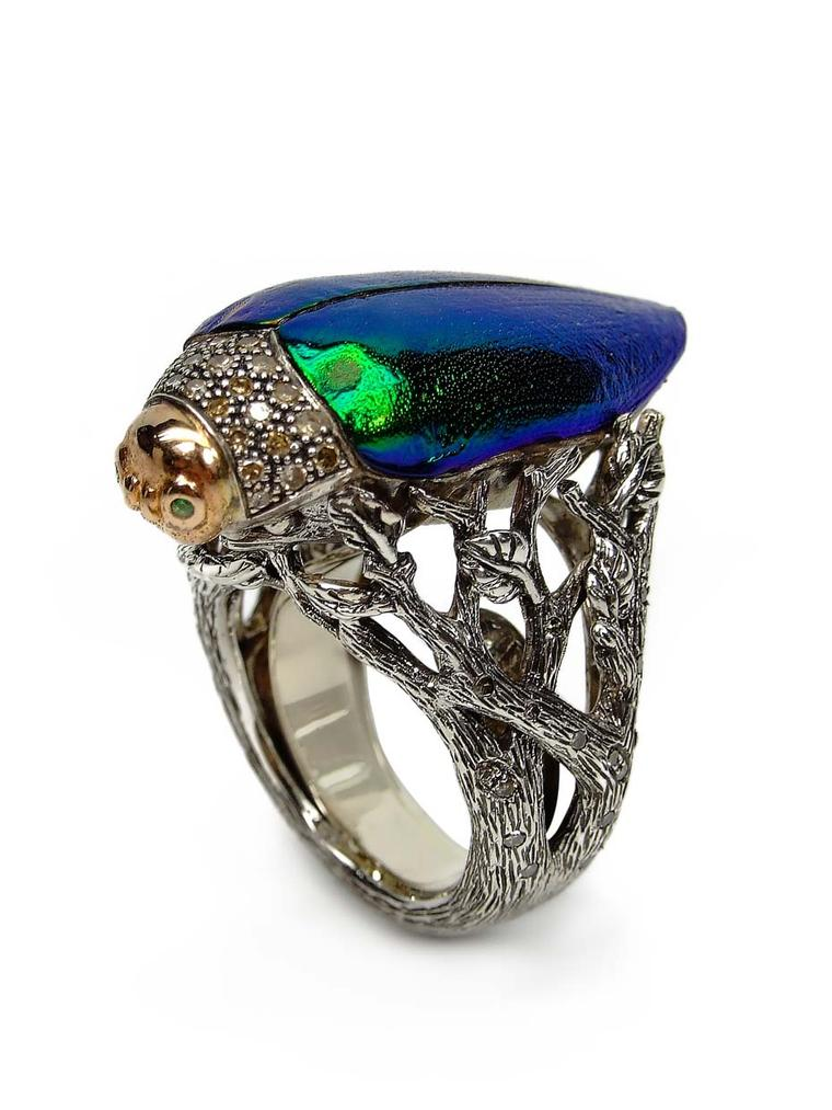 Bibi van der Velden Scarab ring in silver and gold, featuring a scarab wing, green tsavorites and brown diamonds (£1,996).