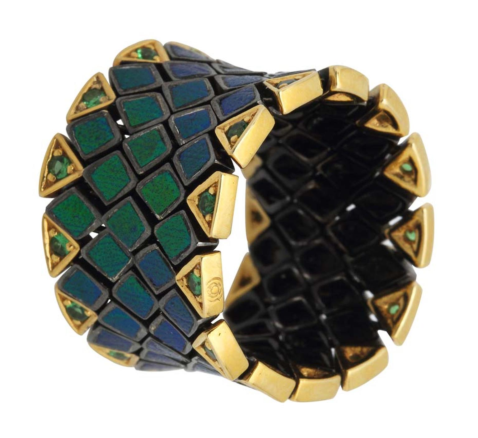 Lotus Arts de Vivre for Katharine Pooley Flexible Scarab ring in flexible silver and gold, with five rows of tsavorites (£2,790).