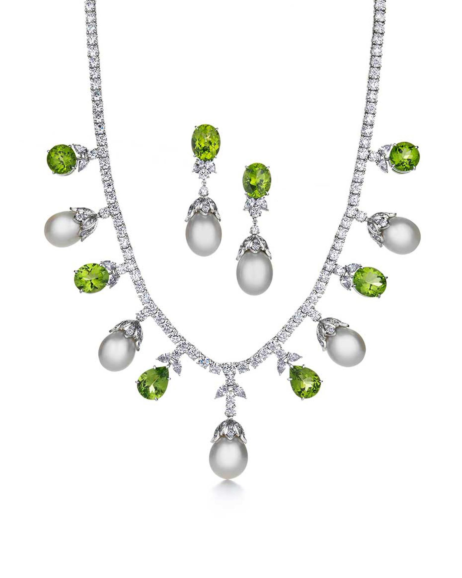 Tiffany & Co. Triple Strand platinum necklace and earrings featuring white South Sea pearls, bright green peridots and diamonds.