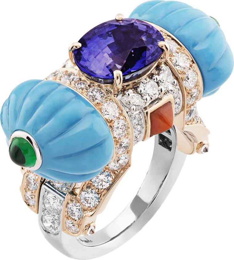 Van Cleef & Arpels Peau d'Âne collection collection white gold ring featuring pink gold, round diamonds, pear, turquoise, coral, emerald cabochon, and a 5.15 ct oval purple sapphire.
