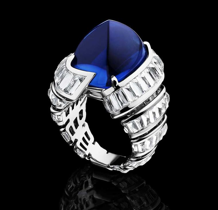 Alexandre Reza Turban ring in platinum with a large sugarloaf cabochon blue sapphire from Ceylon weighing 27.74ct, surrounded by a swirl of baguette-cut diamonds in white gold.