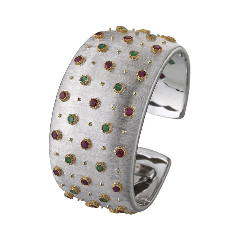 "Buccellati cuff bracelet with emeralds, rubies and diamonds, engraved to resemble silk using the ""regato"" effect."
