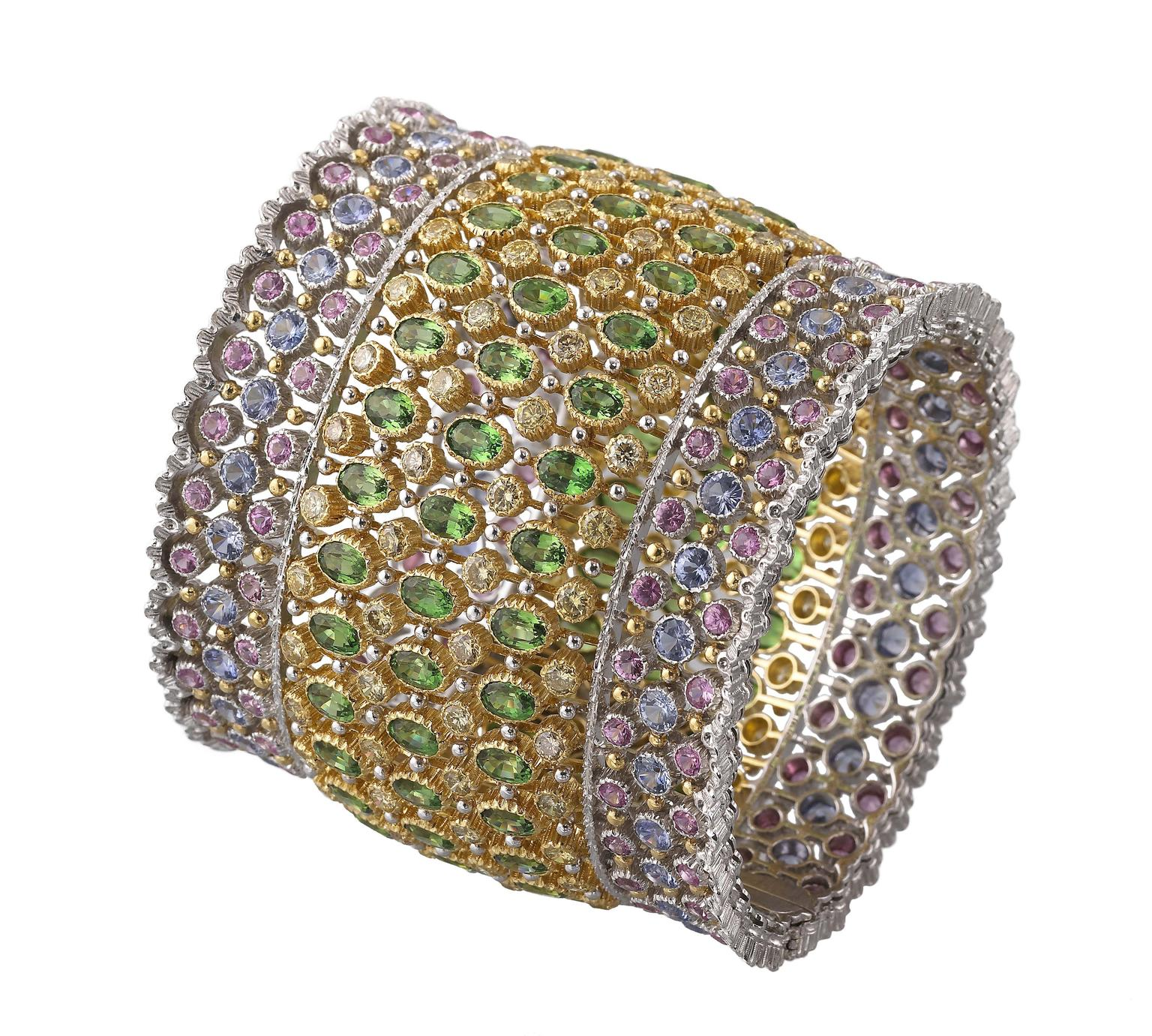 Buccellati cuff bracelet with 51.41ct tsavorites, Fancy diamonds and blue and pink sapphires.
