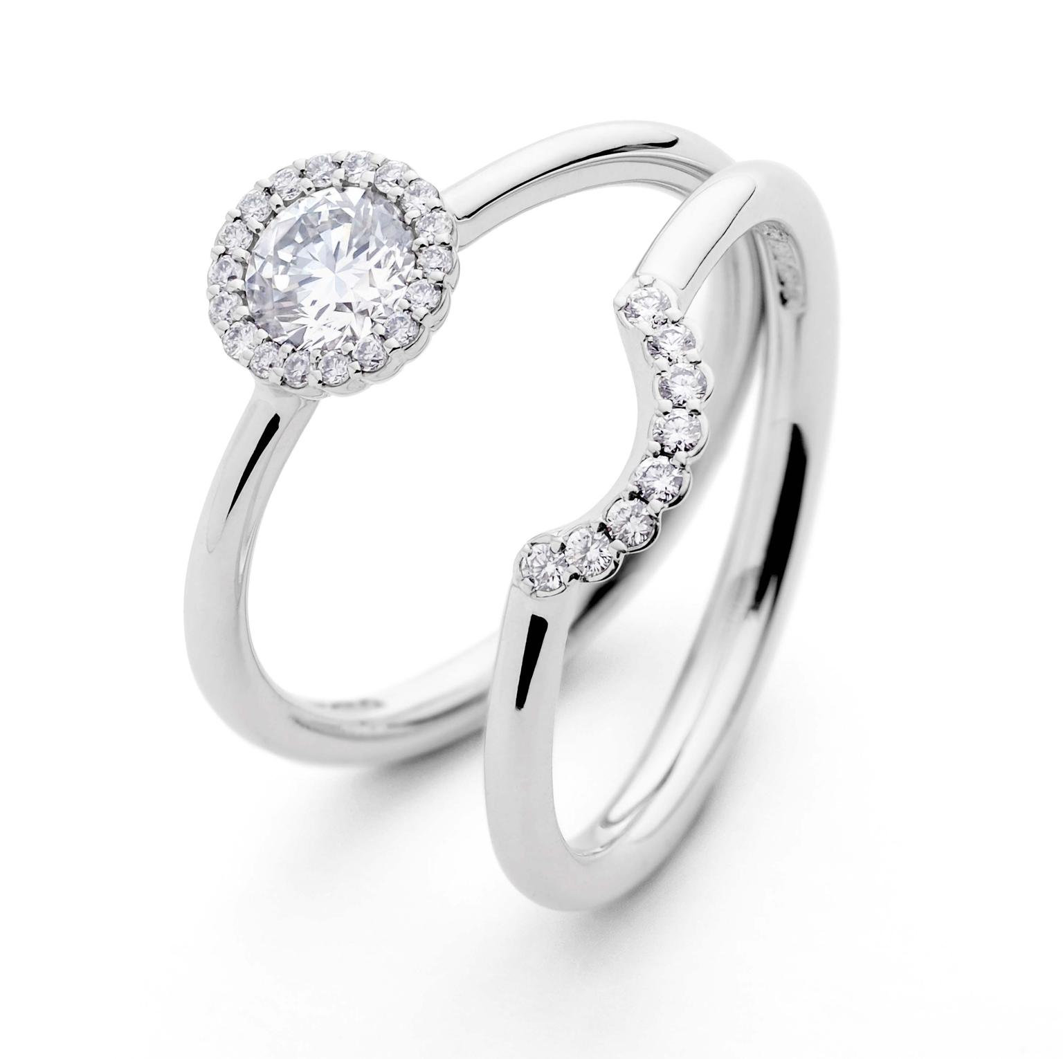 Andrew Geoghegan Cannelé engagement ring and wedding band in white gold with diamonds.