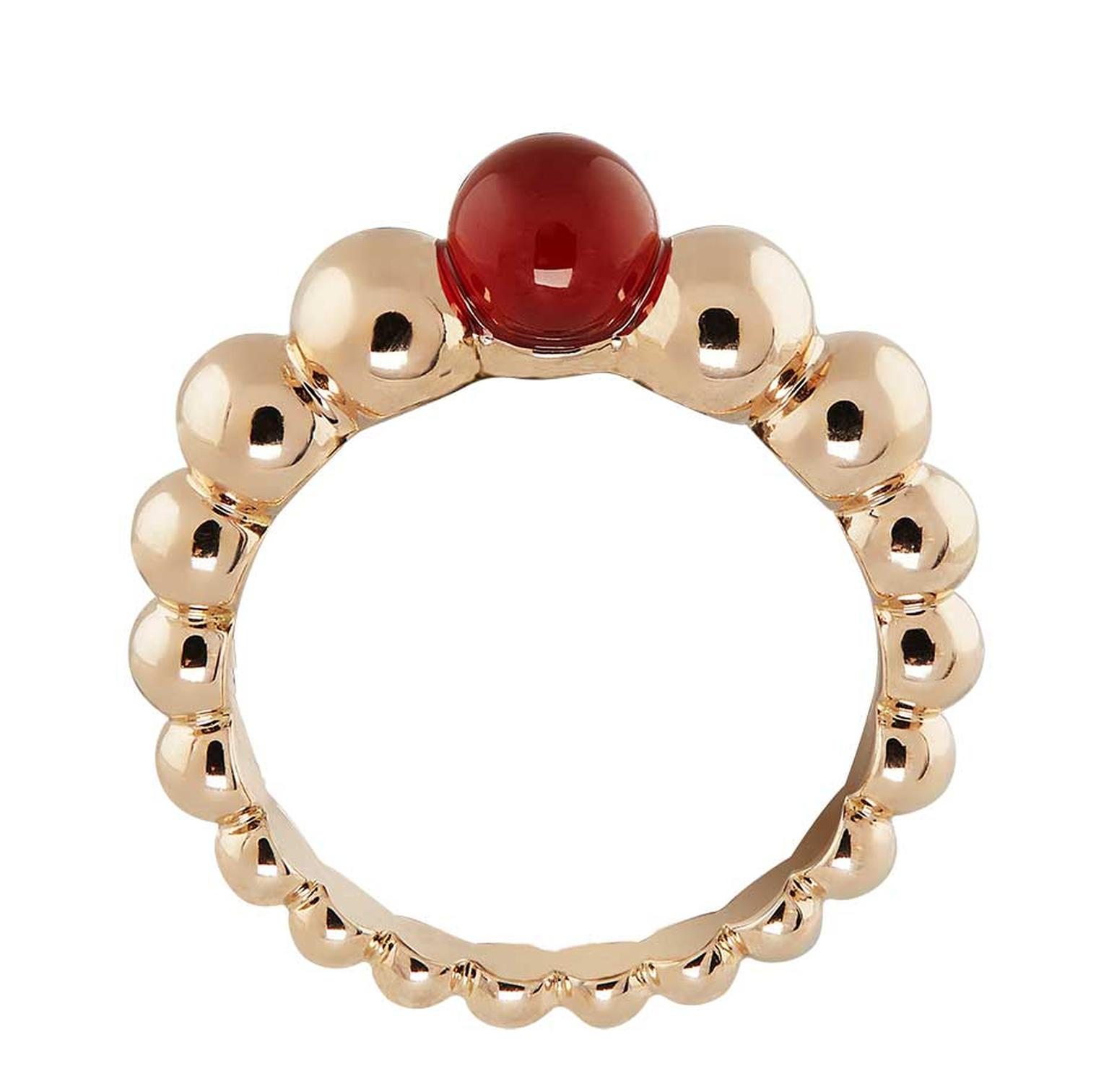 Van Cleef & Arpels Perlée Couleur ring in rose gold with a cabochon cornelian stone.