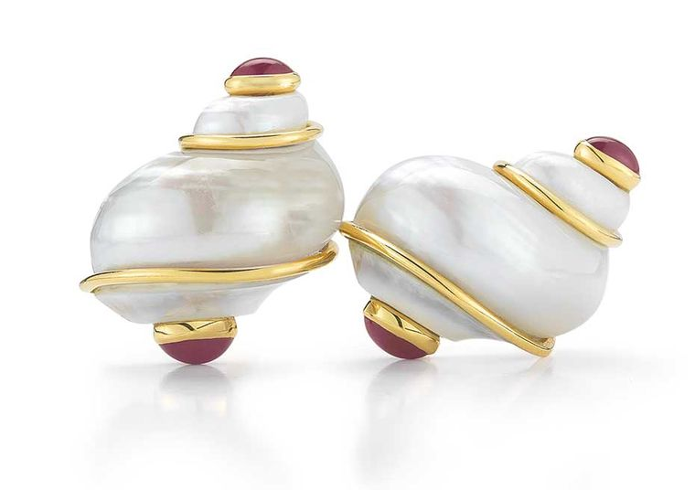 Seaman Schepps Turbo Shell earrings in yellow gold with rubies.