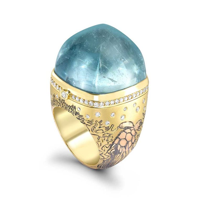 Theo Fennell Hermitage ring in yellow, rose and white gold, topped with a 64.53ct cabochon aquamarine. The ring opens to reveal a ruby-set crab.
