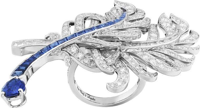 Van Cleef & Arpels Peau d'Ane Happy Marriage collection across-the-finger ring in white gold with round and baguette-cut diamonds, baguette-cut sapphires and one pear-shaped sapphire.