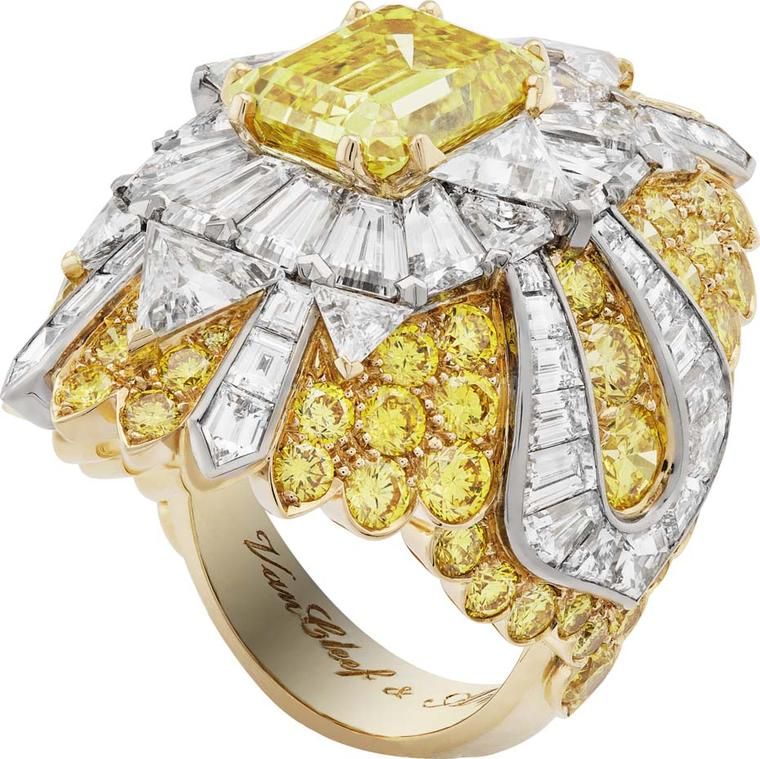 Van Cleef & Arpels Peau d'Ane Happy Marriage collection Heavenly Beauty ring in white and yellow gold with a central Vivid yellow emerald-cut diamond, white trillion-cut diamonds and round and fancy-cut yellow diamonds.