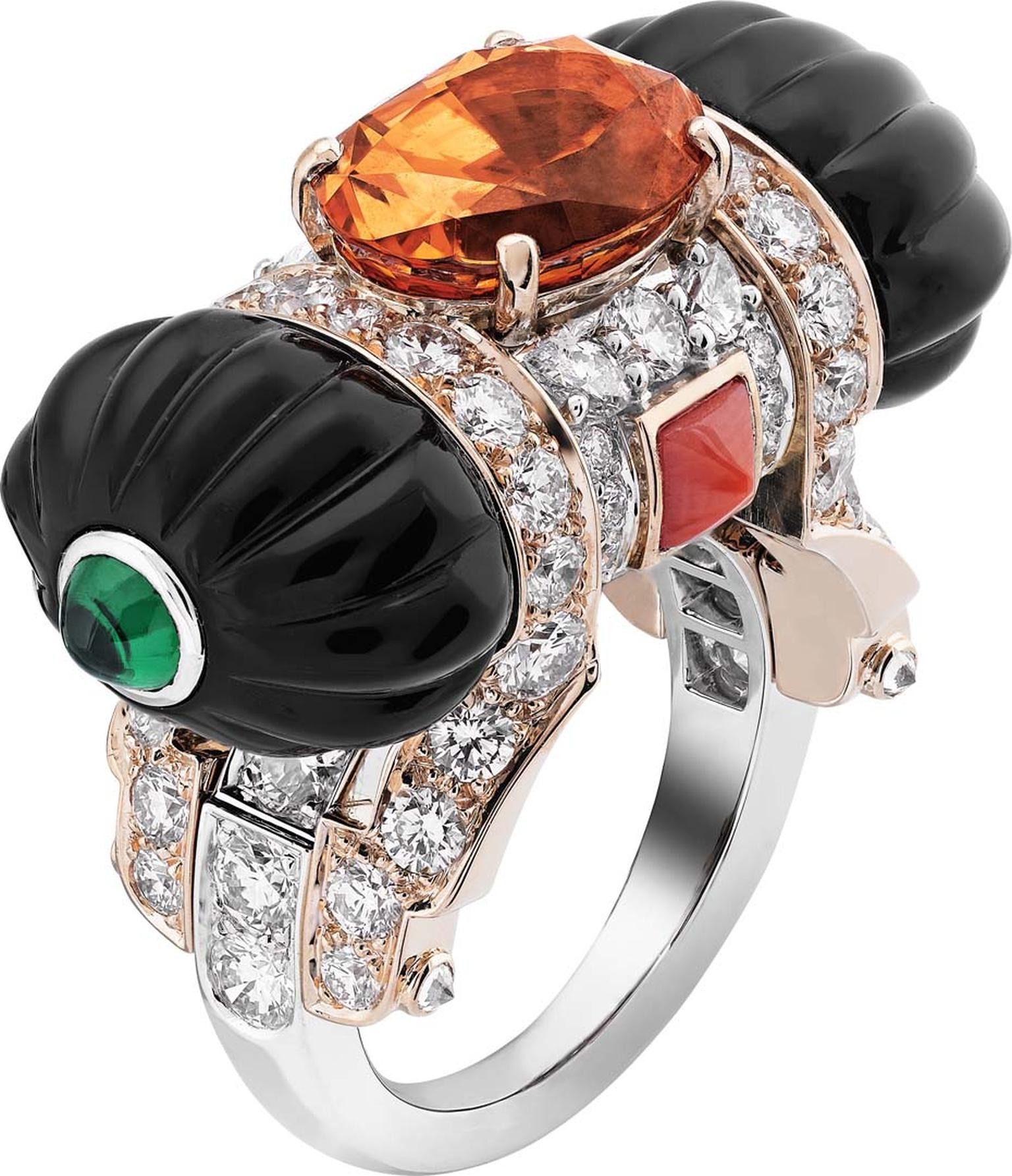 Van Cleef & Arpels Peau d'Ane Happy Marriage collection East Gift ring in white and pink gold with a 5.67ct oval spessartite garnet, round and pear-cut diamonds, onyx, coral and two cabochon emeralds.