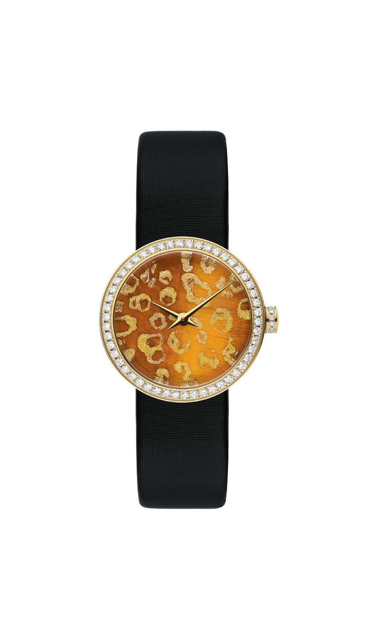 Dior D de Dior Mitza watch in yellow gold with a diamond-set bezel and crown surrounding a tiger's eye stone dial hand-painted with golden leopard spots.