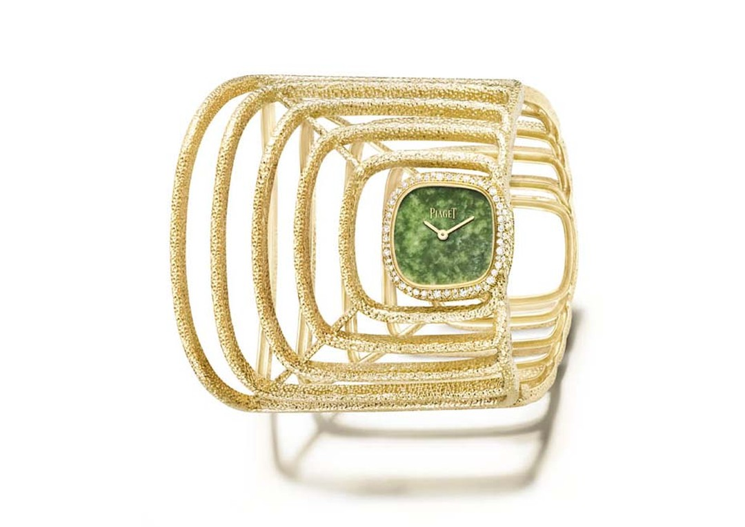 Piaget Extremely Piaget collection cuff watch featuring an off-centred natural jade dial caught in a hammered yellow gold cobweb set with 236 pave diamonds.