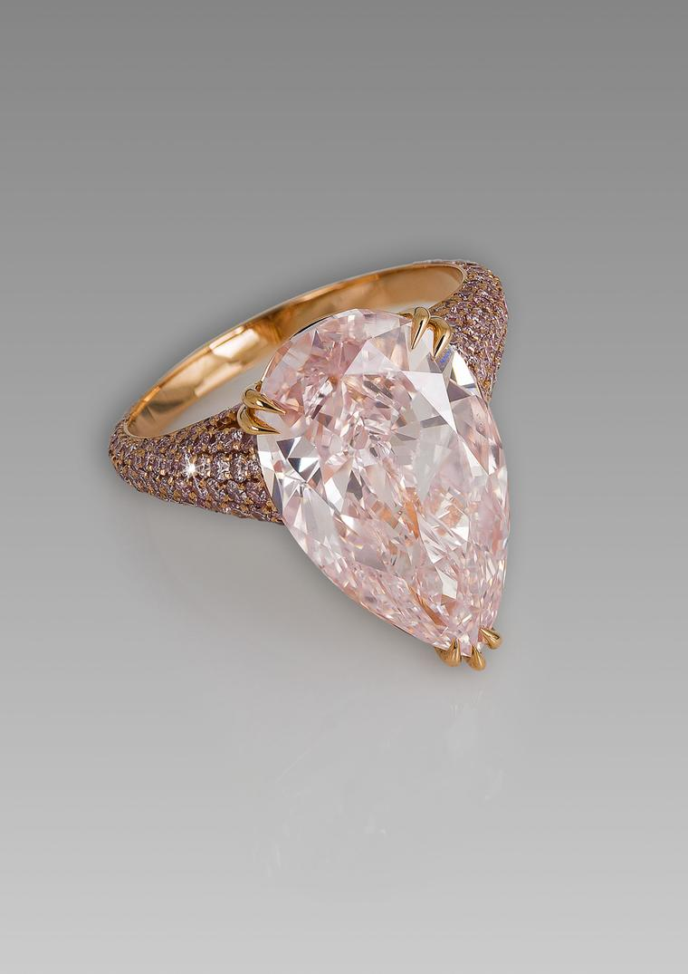 David Morris ring featuring a  pear shaped 8.06ct Fancy pink diamond surrounded by a band of pink diamonds.