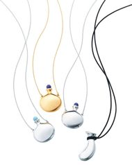 Elsa Peretti for Tiffany Bottle pendants in gold and platinum with hand-carved lapis lazuli and turquoise stoppers.
