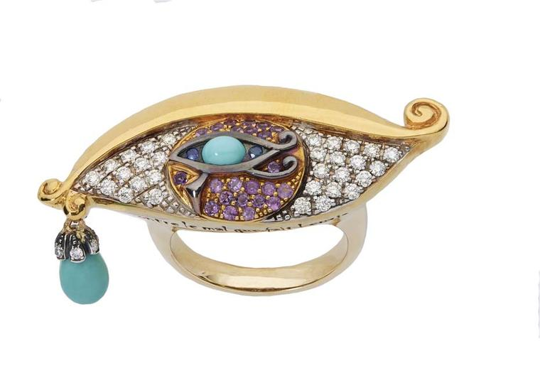 Sylvie Corbelin Fascination collection gold ring featuring diamonds, colourful gem-set irises and a turquoise charm hanging from the tear duct.