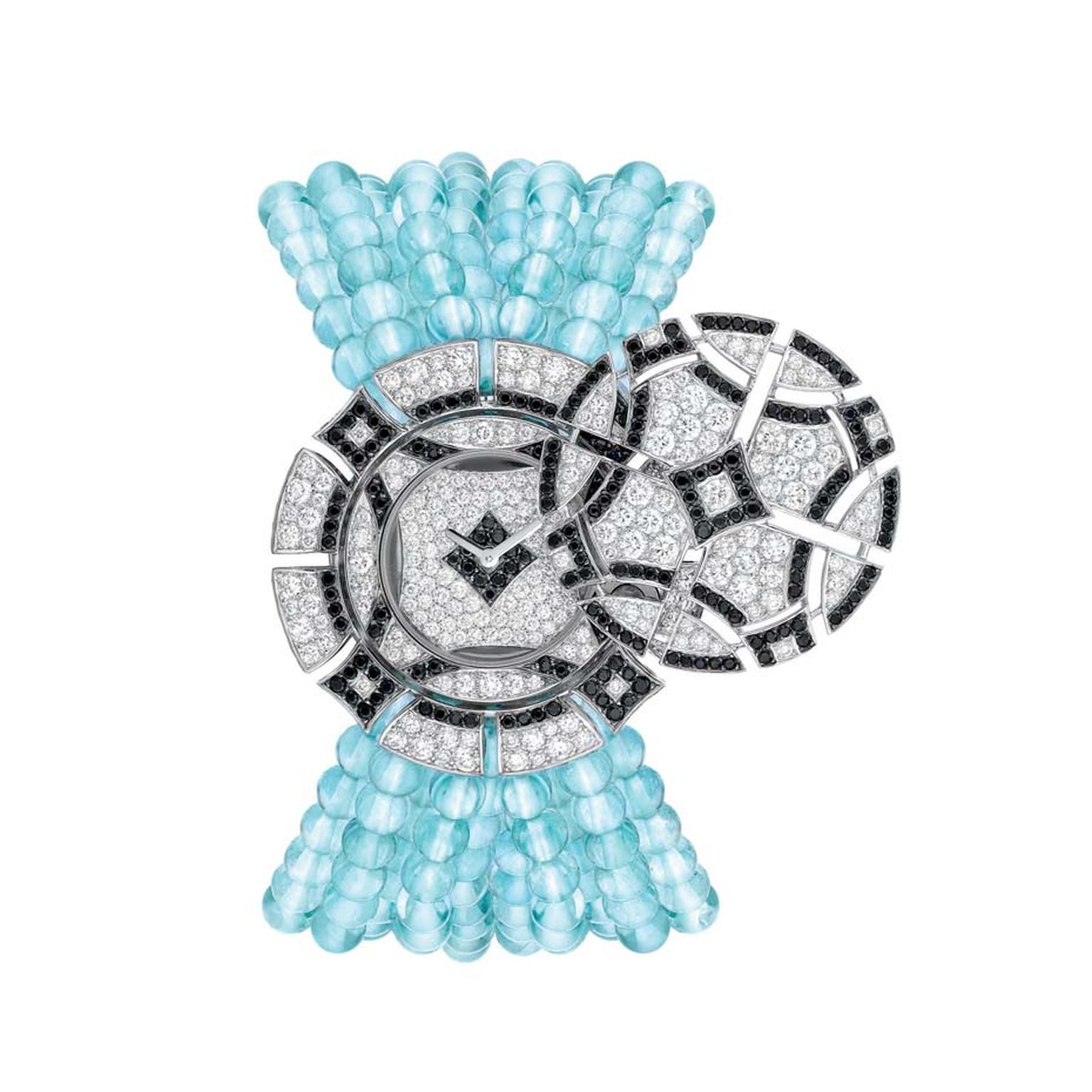 Chanel Café Society Cruise secret watch with an aquamarine bead bracelet contrasted with black spinels and diamonds.