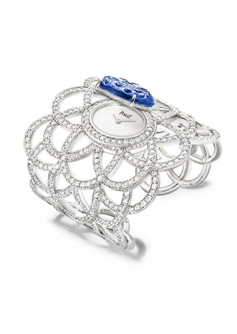 Piaget's Secret watch, from the new Extremely Piaget high jewellery collection, sits on the wrist in a lacey cuff studded with 601 brilliant-cut diamonds and a natural blue opal dial set into an oval-shaped bracelet snow-set with 1,699 diamonds.
