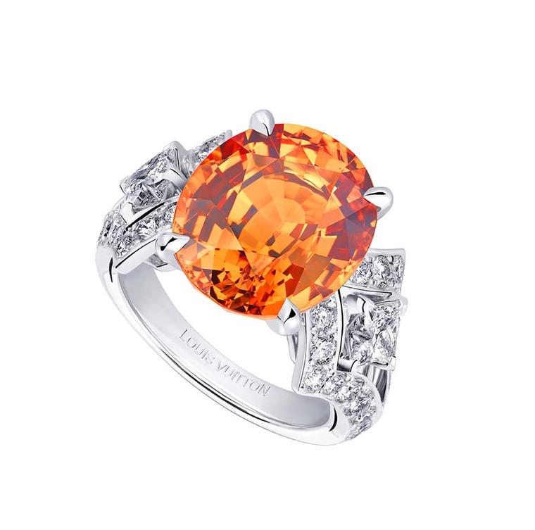 Louis Vuitton Acte V Genesis ring featuring a central mandarin garnet surrounded by diamonds.