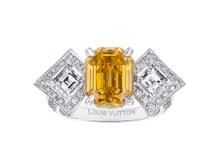 Louis Vuitton Acte V Genesis ring featuring a central orange yellow diamond surrounded by emerald-cut and brilliant-cut diamonds.