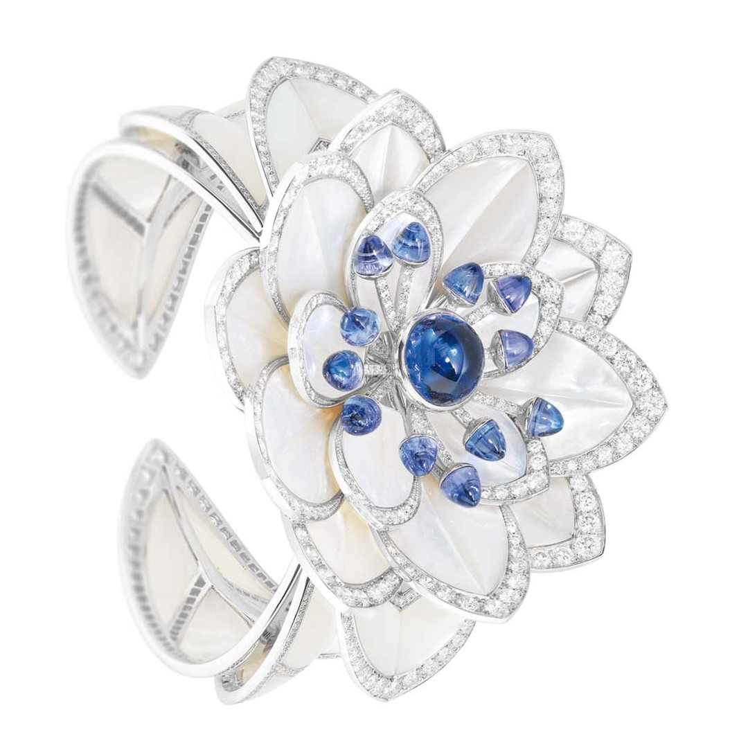 Boucheron Nymphea cuff featuring mother-of-pearl petals, sapphire cabochon pistils and  diamonds, from the Rêves d'Ailleurs high jewellery collection.