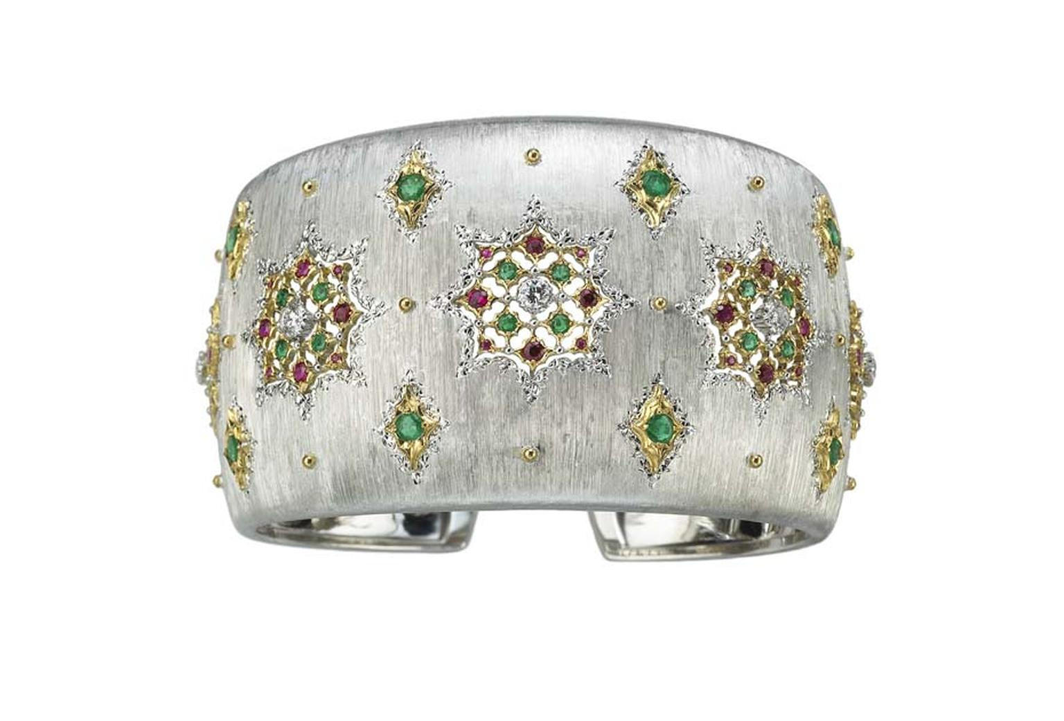 Buccellati Lastra cuff featuring round faceted rubies and emeralds, and brilliant-cut diamonds.