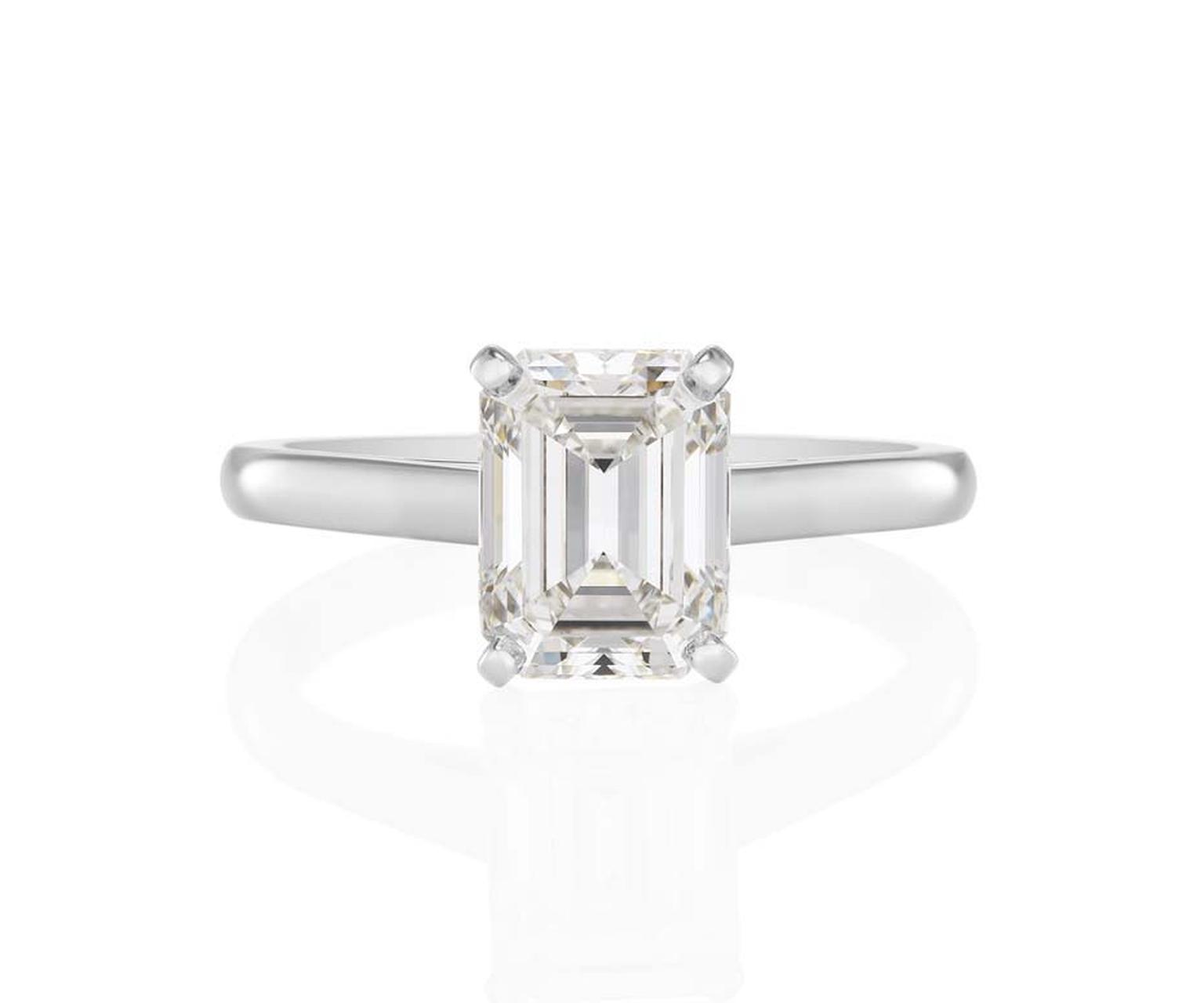 De Beers Classic Solitaire engagement ring featuring a four-prong-set emerald-cut solitaire on a platinum ban