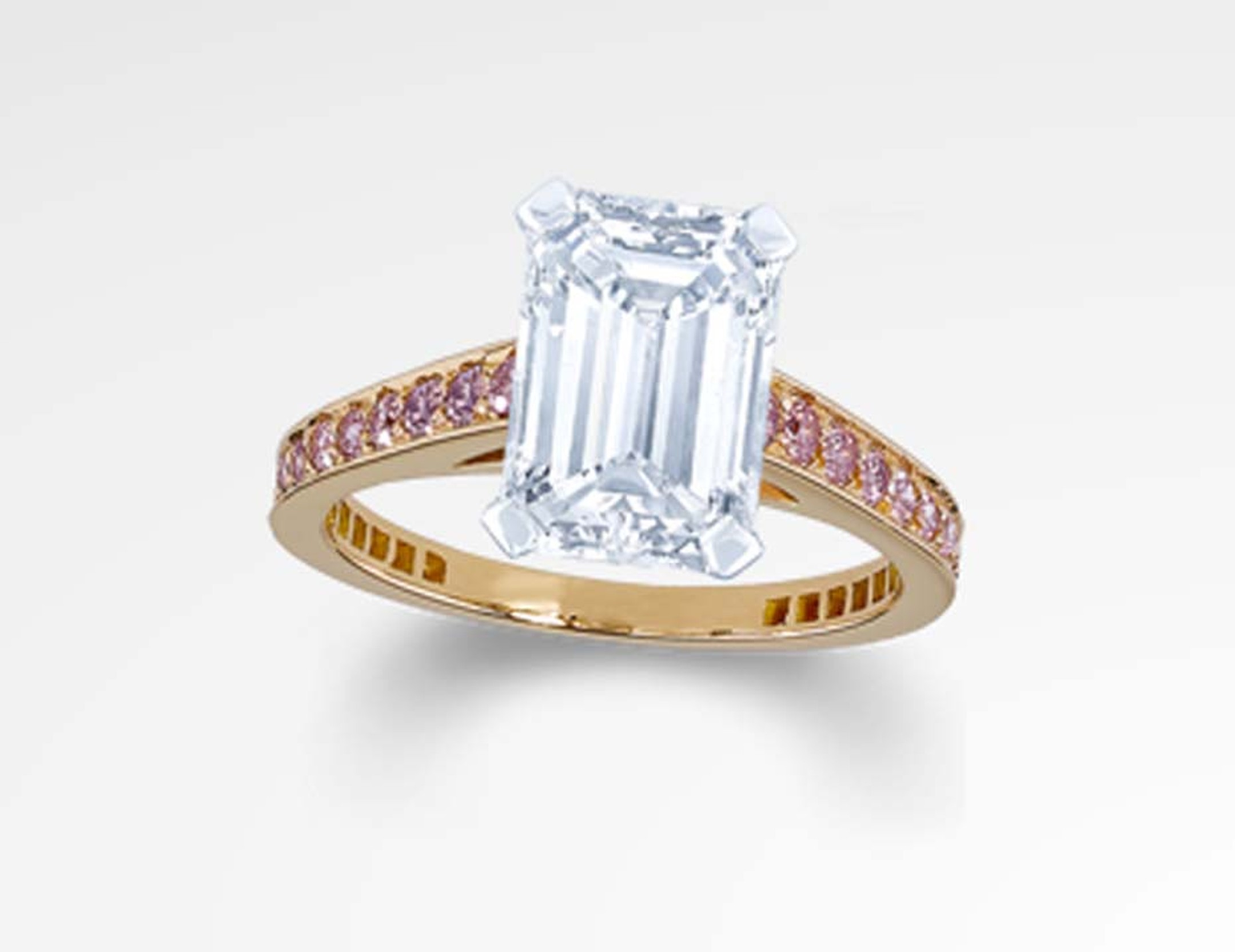 Graff emerald cut engagement ring featuring a rose gold band set with pink pave diamonds.