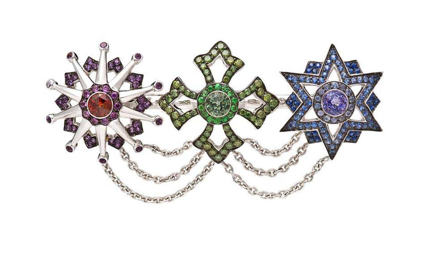 Garrard Star and Garter collection double ring featuring black gold with red garnet, amethyst, green diamond, tsavorites, green tourmaline, tanzanite and blue sapphire.