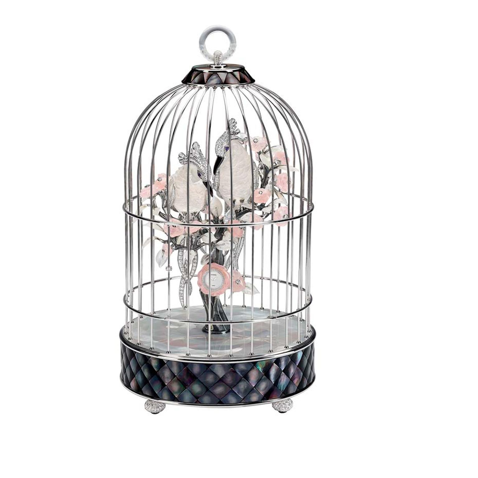 Chanel's white gold Birdcage clock featuring two cockatoos entwined amongst pink camelias features 61.5ct of brilliant-cut diamonds, sculpted moonstone, sculpted pink quartz, rock crystal and gray and white mother-of-pearl.