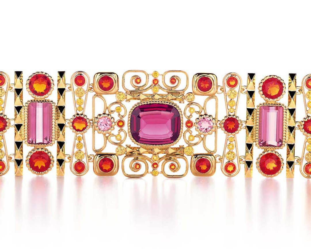 Tiffany & Co. Blue Book bracelet set with yellow diamonds, fire opals, tourmalines and a central cushion-cut garnet.