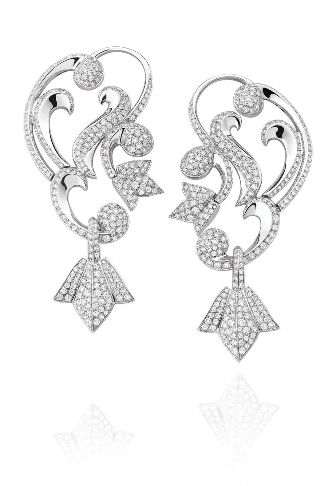 Mellerio dits Meller Secrets de Lys collection diamond ear cuffs in platinum, with swirling arabesques and lily motifs.